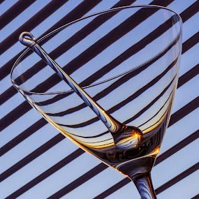sunshine in a glass by Marianna Armata - Artistic Objects Glass ( swizzle, reflection, stick, stipes, burst, object, marianna armata, refraction, curves, sun, macro, champagne glasses, martini, glass, diagonal, lines, zebra, light,  )