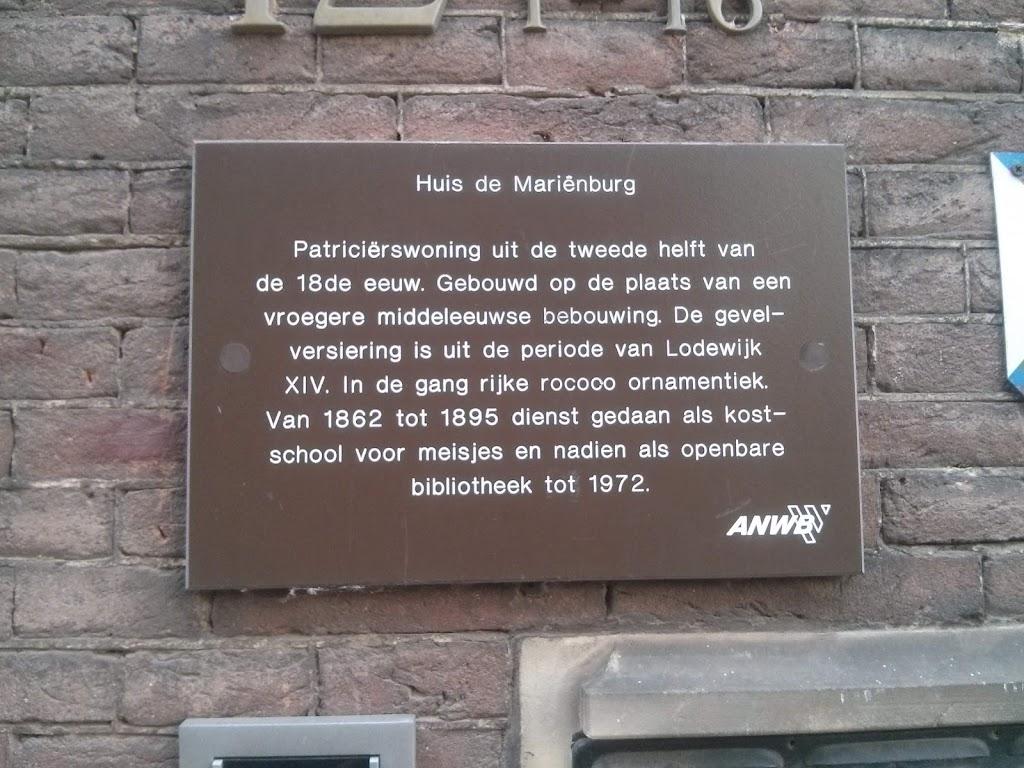 Background:This plaque, placed street-side on a Dutch national monument, describes the history of the building.Original Dutch text:Patricierswoning uit de tweede helft van de 18de eeuw. Gebouwd op de ...