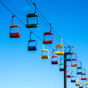 The Chairs by Thomas Shaw - City,  Street & Park  Amusement Parks ( fairgrounds, ride, orange, skyride, sky ride, cable, chairlift, yellow, steel, raleigh, north carolina, chair, sky, red, pole, nc, blue, chair lift, empty )
