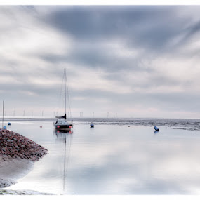 Peaceful by Jon Hunter - Landscapes Waterscapes ( water, clouds, sand, vessel, sailing, still, beach, boat, rocks )
