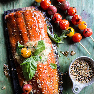 Cedar Plank Grilled Sesame Salmon with Kimchi Miso Butter and Grilled Tomatoes.