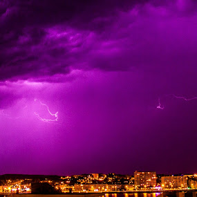 Thunder and lightning over the bay. by Roger Hamblok - Landscapes Cloud Formations ( clouds, shore, flash, reflection, sea, cityscape, panorama, city, lights, lightning, pano, bay, cloud, night, panoramic, skyscape,  )