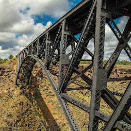 High Above the Gorge Tracks by Judi Kubes - Transportation Railway Tracks ( clouds, tressel, iton, metal, gorge, cliff, train, rock, architecture, high, tracks,  )
