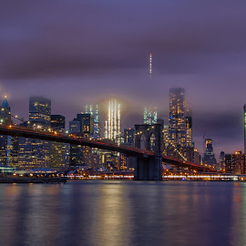 Cloudy Manhattan  by Carol Ward - City,  Street & Park  Skylines ( night time, dumbo, nyc, city, brooklyn )