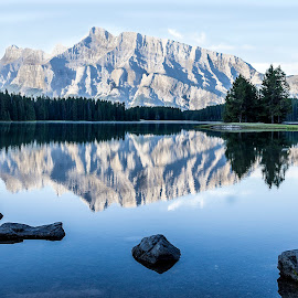 early morning mountain reflection by Frank Barnitz - Landscapes Mountains & Hills ( national park, mountain, colorful, canadian rockies, horizontal, reflections, trees, solitude, lake, travel, banff, rocks )