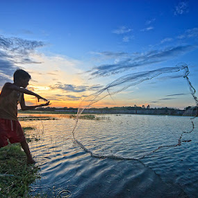 The Young Fisherman by Arnab Sarkar - People Street & Candids ( canon, water, twillight, west bengal, action, india, fishing, fisherman, young, pond, rural )