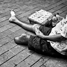 Means Of Life by Jonathan Danker - News & Events World Events ( singapore bencoolen people life street monochrome hardship amputee man )