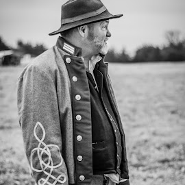 B&W old warrior by Eva Ryan - People Portraits of Men ( oklahoma, uniform, outdoors, male, black & white, battle of round mountain, beard, civil war re-enactment, yale_ok, buttons, man, hat )