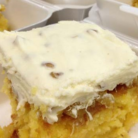 Pineapple Poke Cake with Pineapple Sauce and Cream Cheese Topping