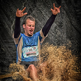 Splashing In The Brown Soup ! by Marco Bertamé - Sports & Fitness Other Sports ( water, differdange, splash, splatter, 2015, number, eyes closed, waterdrops, soup, luxembourg, mud, sliding, strong, blue, fingers, dirty, drops, brown, 399, strongmanrun, man,  )