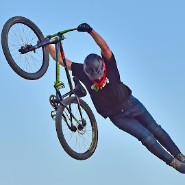 The Rocket Man by Marco Bertamé - Sports & Fitness Other Sports ( flying, sky, wheel, blue, air, round, high, circle, dow, stunt, straight, jump, bicycle )