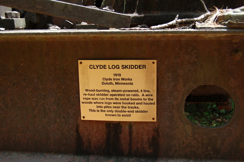 Clyde Log Skidder 1919   — Clyde Iron Works Duluth, Minnesota — Wood burning, steam powered, 4 line, re-haul skidder on wheels. A wire rope was run from its metal booms to the woods where logs were ...