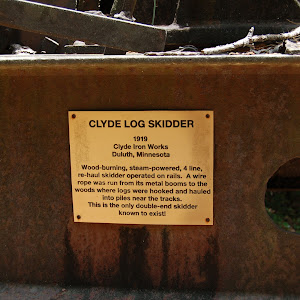 Clyde Log Skidder 1919 — Clyde Iron Works Duluth, Minnesota —Wood burning, steam powered, 4 line, re-haul skidder on wheels. A wire rope was run from its metal booms to the woods where logs were ...