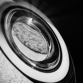 Tire Glow  by Jim Signorelli - Black & White Objects & Still Life ( wheel, car wheel, tire, vintage wheel )