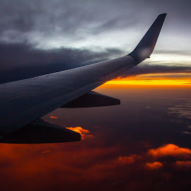 sunset flight by Michael Strier - Transportation Airplanes ( clouds, flight, wing, plane, sunset, sun )
