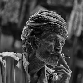 Nicotine Break by Avanish Dureha - People Portraits of Men ( incrdible indis, pushkar, sunset, rajasthan, dureha@gmail.com, musician, india, avanish dureha )