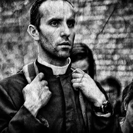 Priest by Jose Hernan Cibils - City,  Street & Park  Street Scenes ( priest, rom, black and white, street, people )