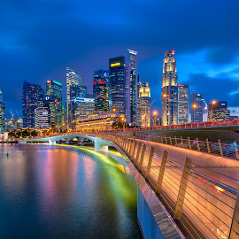 The Bridge and the Business District by Binoy Uthup - City,  Street & Park  Skylines ( singaporejubileebridge, waterscape, jubileebridgesingapore, architecture, cityscape, singapore, city, blue sky, night photography, long exposure, bridges, cityscapes, water, digital bledning, hdr, night scene, blue hour, hdr photography, singapore river, nightscape, urban, night view, blue, architectural, night, bridge, night shot, jubileebridge )
