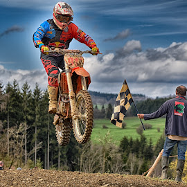 The Finish Flag by Marco Bertamé - Sports & Fitness Motorsports ( clouds, finish, red, blue sky, flag, motocross, speed, number, 911, race, noise, jump )