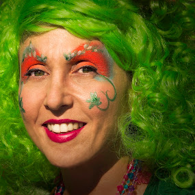 Woman at street fair by Fran Gallogly - People Street & Candids ( street fair, woman, festival, green hair, paint, mardi gras, pwccandidcelebrations, painted face, face painting )