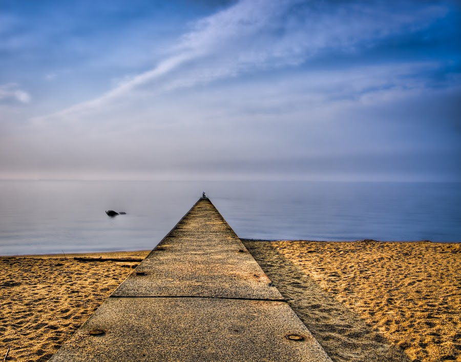 Out to Sea by JJ Richards - Landscapes Waterscapes ( clouds, water, sand, sky, pier, sea, beach, milford, ct, concrete )