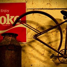 ANTIQUES!. by Steve Cooper - Artistic Objects Antiques ( coke, faded wall paint, milk cans, flourescent/natural blend of lighting, bicycleframe )