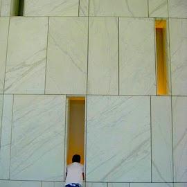 No Peeking! by Ronnie Caplan - People Street & Candids ( interior, vertical, tiles, pattern, horizontal, openings, lines, office building, boy, wall )