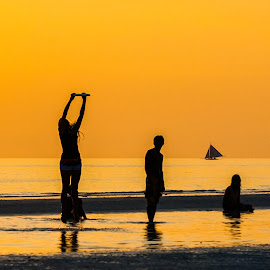Reach for Gold by Ynon Francisco - Sports & Fitness Other Sports ( water, fitness, silhouette, play, sports, reflections, sea, game, teens, fun, kids, beach, sailboat, shadows, boracay, wellness, firsbee, activities, philippines, golden hour )