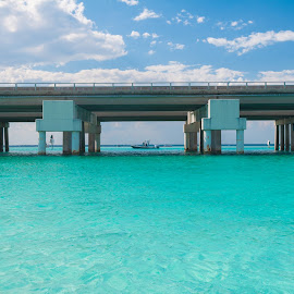 Still by Brianne Toma - Buildings & Architecture Bridges & Suspended Structures ( green, below, florida, lone, water, boat, destin, tropical, alone, ocean, blue, waterscape, beach, above, vacation, bridge, bay, travel, landscape )