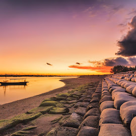 Lonely boat by Olga Parshina - Landscapes Sunsets & Sunrises ( clouds, bali, sky, colorful, indonesia, colors, sunset, cloud, low tide, beach, boat, lonely )