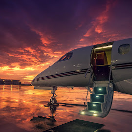 Sunset flying for the rich by Richard Depinay - Transportation Airplanes ( flying, embraer, 300, phenom, sunset, wet, jet, ramp, private )