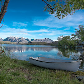 Lake Alexandrina  by Todd Cunnard - Landscapes Waterscapes ( clouds, water, row boat, waterscape, green, lake, nz, boat, new zealand, cloud formations, mountains, blue sky, lake alexandrina, tree, blue, cloud, trees, dingy, alps )