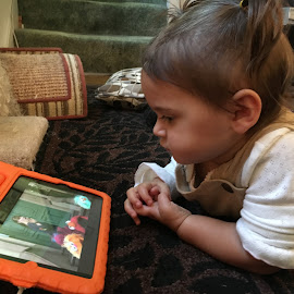 Entranced by Kristine Nicholas - Novices Only Portraits & People ( child, screen, orange, girl, infant, ipad, baby, toddler, disney, video, kid )