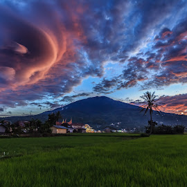 Sunset at Singgalang Mountain by Teddy Winanda - Landscapes Cloud Formations ( clouds, altocumulus lenticularis, mountains, paddy field, sky, mountain, village, mount, altocumulus, altocumulus mackerel, landscape )