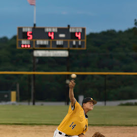 Max Effort by Doug Craigmile - Sports & Fitness Baseball ( rubber, ball, jersey, scoreboard, 3 and 0, american flag, sports, pitcher, score, 4th inning, inning, 14, infield, 5 to 4, flag, baseball, dirt, pitch )
