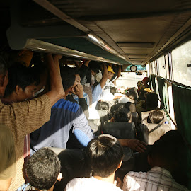 crowded bus by Rahmat Nugroho - People Group/Corporate ( bus, station, waiting, hundreds, people, human, passengers, sitting, indonesia, busstop, gathering, group, crowd, crowded )