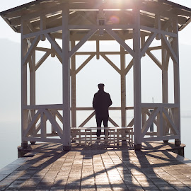 Early Morning Solace by Lisa Klein - People Portraits of Men ( water, peaceful, wood, solitude, lake, quiet, sunlight, morning, shadows, portrait, fog, sunny, magical, shadow, serene, outdoors, day, gazebo, misty, man, mist )