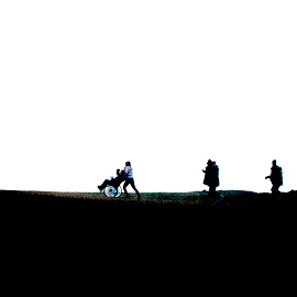 On the way home by Staffan Håkansson - People Group/Corporate ( wheelchair, silhouette, horizon, stone, people, solar eclipse, sun )
