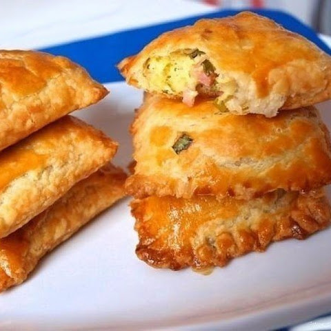 Pies From Flaky Pastry With Green Onions, Cheese And Ham