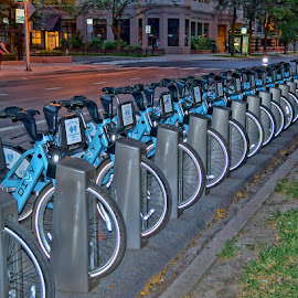All Lined Up by Luanne Bullard Everden - Transportation Bicycles ( bicycles, night, chicago, transportation, glow )