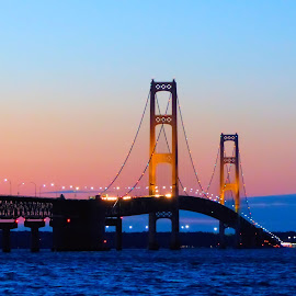 Dusk Falls On The Straights of Mackinac by Dean Ramsay - Buildings & Architecture Bridges & Suspended Structures ( upper peninsula, michigan, lake michigan, lake huron, sunset, mackinaw city, lower peninsula, bridge, mackinac bridge )