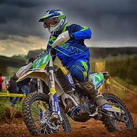 Blue Express by Marco Bertamé - Sports & Fitness Motorsports ( 21, clouds, motocross, blue, speed, green, dust, clumps, number, yellow, race, accelerating, noise )