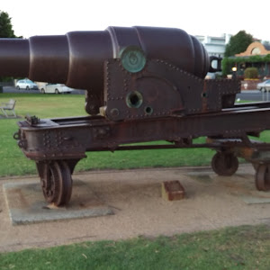 Small plaque at the bottom reads:'Sir William Armstrong Rifled Muzzle loading gun 1867Originally installed at Port GerribrandWilliamstown City Council ...