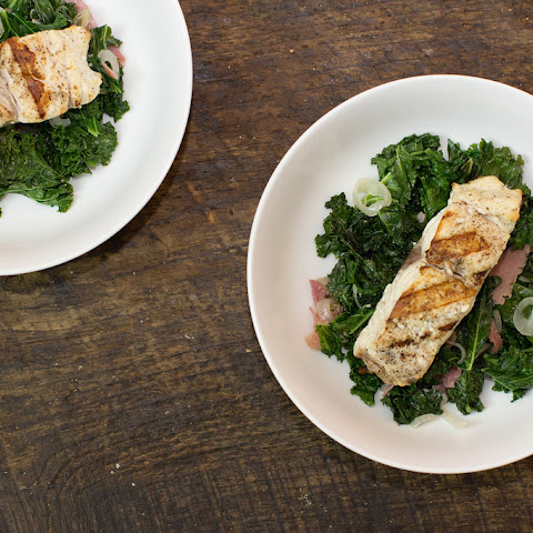 Grilled Bass over Kale and Prosciutto Salad