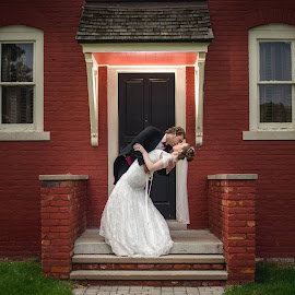 the dip by Alexander Zacharov - Wedding Bride & Groom ( love, wedding photography, school, red, dip, brick, house, bride and groom )