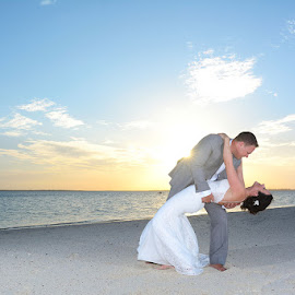 Dip by Andrew Morgan - Wedding Bride & Groom ( love, zanzibar, sky, beachwedding, wedding, sunset, beach, bride, groom )