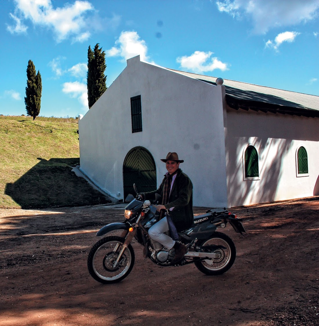 Hamilton Russell, owner of Hamilton  Russell Vineyards, rides his bike around the farm