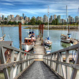 Sailing We Will Go by Ernie Kasper - Landscapes Travel ( water, clouds, wood, waterscape, false creek, boats, transportation, architecture, landscape, steel, vancouver, dock, city, ramp, sky, sailboats, buildings )