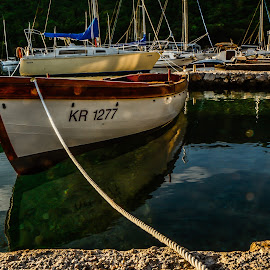 in a quiet harbor by Eseker RI - Transportation Boats (  )