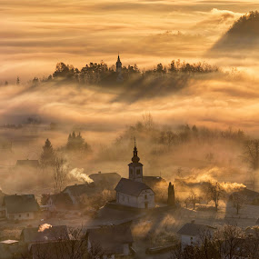 Golden Villages by Aleš Krivec - Landscapes Sunsets & Sunrises ( haze, hills, mountain, travel, valley, house, yellow, landscape, city, sky, tree, village, autumn, rise, bled, gold, light, misty, clouds, hill, church, dream, wallpaper, forest, morning, smoke, rural, fog, slovenia, view, sunrise, town, golden, early, mist )